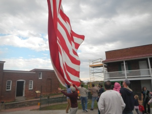 Helping take down the flag (Isaac in hat at center)